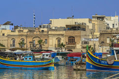 Malta, Marsaxlokk. Small but picturesque harbour to the south-east with the brightly coloured fishing boats ride at anchor, Marsaxlokk, Malta Stock Photos