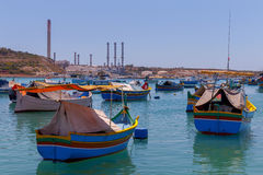Malta. Marsaxlokk. Traditional fishing boats. Traditional multicolored fishing boats Luzzi in the harbor Marsaxlokk. Malta Royalty Free Stock Images
