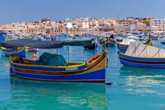 Malta. Marsaxlokk. Traditional fishing boats. Traditional multicolored fishing boats Luzzi in the harbor Marsaxlokk. Malta Stock Photos
