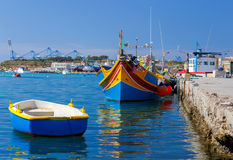 Malta. Marsaxlokk. Traditional fishing boats. Traditional multicolored fishing boats Luzzi in the harbor Marsaxlokk. Malta Royalty Free Stock Image