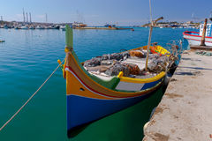Malta. Marsaxlokk. Traditional fishing boats. Traditional multicolored fishing boats Luzzi in the harbor Marsaxlokk. Malta Stock Images