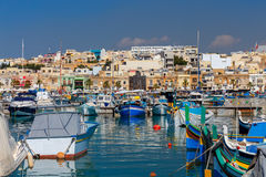 Malta. Marsaxlokk. Traditional fishing boats. Traditional multicolored fishing boats Luzzi in the harbor Marsaxlokk. Malta Stock Image