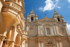 Malta, Mdina: Luxury Baroque architecture. Landscape of St. Pauls`s Cathedral, built in Baroque architecture style in Mdina, Malta. It is locate in the centre of Stock Photos