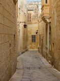 Malta, Mdina. Old medieval city narrow streets, houses sandstone facades. Mdina, Malta island. Old medieval city narrow streets, houses sandstone facades and Royalty Free Stock Photo