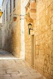 Malta, Mdina. Old medieval city narrow streets, houses sandstone facades. Mdina, Malta island. Old medieval city narrow streets, houses sandstone facades and Stock Photography