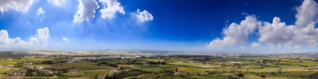 Malta, Mdina. Panoramic view from Mdina castle. Malta island, Mdina. Panoramic view of surrounding countryside from the castle at spring. Blue sky background Stock Photo