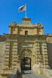 The medieval citadel of Mdina. Narrow stone bridge over a moat and a Baroque main gate constructed in 1724, entrance to  the Silent City, government and Stock Image