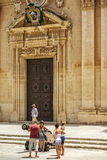 The medieval citadel of Mdina. Holiday-makers in front of the Cathedral of St Paul in the walled Silent City, government and administrative centre during the Royalty Free Stock Photo