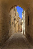 The medieval citadel of Mdina. Narrow street in the Silent City, government and administrative centre during the medieval period, Mdina, Malta Royalty Free Stock Photography