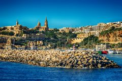 Malta: Mgarr, a harbour town in Gozo island. Mediterranean Sea Stock Images