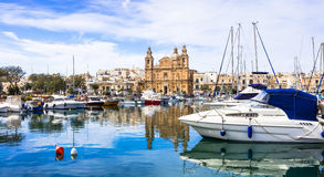 Malta - Msida cathedral and marina. Landmarks of Malta - Msida cathedral and marina with the sail boats Stock Photo