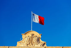Malta. National Flag. National flag of Malta against the blue sky in Valletta Stock Photography