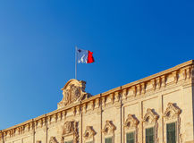 Malta. National Flag. National flag of Malta against the blue sky in Valletta Royalty Free Stock Photos