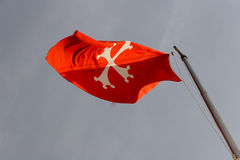 Malta National Flag. Flying Malta National Flag - White cross on red Royalty Free Stock Photography