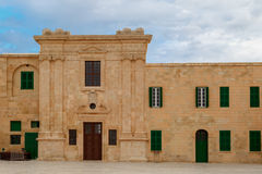 Malta National War Museum. View of National War Museum in Valletta, Malta with high yellow stone walls, on cloudy sky background Royalty Free Stock Photography