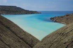 Malta nature, cliffs in malta, Ramla Bay in Malta, maltese landscape with the hill and different blue colour sea on sunny day, sce Stock Photo