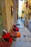 La Valletta Cafe Entrance, Sidewalk Steps Area, Outdoor Section, Malta, Travel Europe. Malta, November, 2017 - La Valletta cafe entrance with red double door and Royalty Free Stock Photos