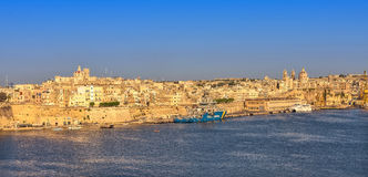 Malta - Panorama of Valletta. Impressive view of the Maltese capital across Grand Harbour from Vittoriosa - Valletta, Malta Royalty Free Stock Photography