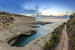 Malta - Panoramic view of the sunrise at St.Peter`s pool. Delimara Royalty Free Stock Photo