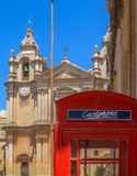 Malta Phonebooth. British style phonebooth with St Paul's cathedral behind in Mdina, Malta Stock Images