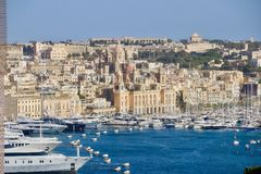 Malta: Port Town of Birgu and Kalkara captured from Valetta. Port town of Birgu and Kalkara captured from old Valetta, boats and ships in the port Stock Photo