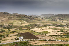 Malta before rain. Typical landscape view in Malta with cultivated fields the rain is coming Royalty Free Stock Photos