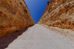 Malta. The road between rocks. A narrow canyon and road between rocks near village Popeye. Malta Stock Photos