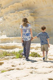 Malta rocky coastline, brother and sister walk together Stock Photography