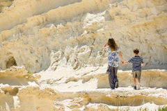 Malta rocky coastline, brother and sister walk together Royalty Free Stock Images
