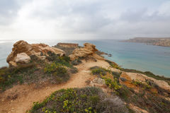 Malta's seascape. Maltese rocky seascape, island's west side, Riviera Bay, Malta Royalty Free Stock Images