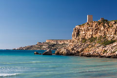 Malta's seascape. Maltese rocky seascape and Ghajn Tuffieha Tower, Riviera Bay, Malta Royalty Free Stock Image