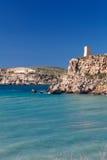 Malta's seascape. Maltese rocky seascape and Ghajn Tuffieha Tower, Riviera Bay, Malta Stock Photography