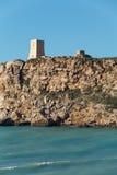 Malta's seascape. Maltese rocky seascape and Ghajn Tuffieha Tower, Riviera Bay, Malta Stock Images