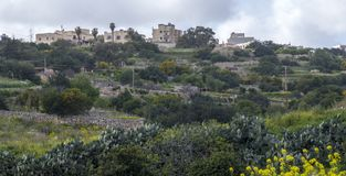 Malta - San Juan town view from Swieqi valley. Malta - View of San Juan town from the valley of Swieqi town Royalty Free Stock Photography