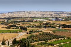 Malta scenery. View from Mdina on Malta countryside with the football stadium in the background as well as the towns of Naxxar in the background Royalty Free Stock Photos