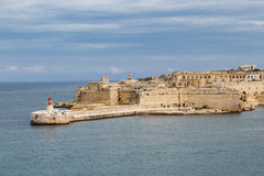 Malta Seascape View. General view of Valletta, Malta island with seascape, port and historical limestone buildings from medieval times Royalty Free Stock Photo