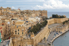 Malta Seascape View. VALLETTA, MALTA - OCTOBER 30, 2015 : General view of Valletta, Malta island with seascape, port and historical limestone buildings from Royalty Free Stock Images