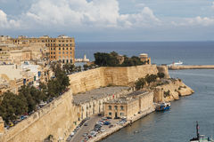 Malta Seascape View. VALLETTA, MALTA - OCTOBER 30, 2015 : General view of Valletta, Malta island with seascape, port and historical limestone buildings from Stock Photo