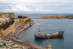 Malta Seascape View. VALLETTA, MALTA - OCTOBER 30, 2015 : General view of Valletta, Malta island with seascape, port and historical limestone buildings from Stock Photos