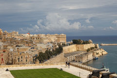 Malta Seascape View. VALLETTA, MALTA - OCTOBER 30, 2015 : General view of Valletta, Malta island with seascape, port and historical limestone buildings from Stock Photography