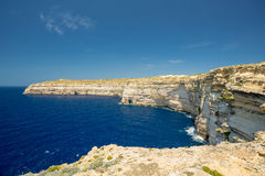 Malta shoreline cliffs. Ble water and sky Royalty Free Stock Image