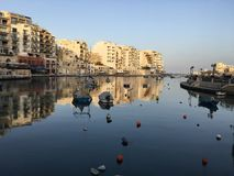 Malta Spinola Bay Open Sea View. Beauty of living on a small island in the Mediterranean sea is in its views, breeze, and a breath-taking coastline. Cafe-crowded Stock Image