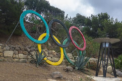 Malta, Streets of St Pauls Bay. Olympic rings in abandoned Olympic Garden (Masgar Olimpiku) at Xemxija Bay, St Pauls Bay, San Pawl il-Baħar, Malta Stock Photo