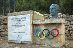 Malta, Streets of St Pauls Bay. Olympic rings and the bust of Pierre de Coubertin in abandoned Olympic Garden (Masgar Olimpiku) at Xemxija Bay, St Pauls Bay Stock Image