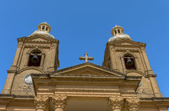 Churches of Malta - Dingli. Bell towers of the parish church of Assumption of the Blessed Virgin Mary into Heaven in unremarkable and picturesque little village Stock Photography