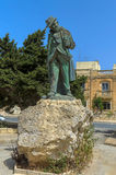 Malta, Streets of Dingli. Monument to Guze Ellul Mercer (by Anton Agius, 1986) in the heart of unremarkable and picturesque little village of Dingli, Malta Royalty Free Stock Photo