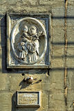 Malta - Streets of Mosta. Limestone bas-relief (St Anthony holding Baby Jesus) on an old building - Mosta, Malta Royalty Free Stock Images