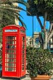 Malta - Streets of Mosta. Red British-style phone booth outside Santa Marija Assunta - Mosta, Malta Royalty Free Stock Photos
