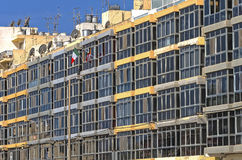 Malta, Streets of Qawra. Windows or glass facade of a building built in the middle of the 60s, Qawra, Malta Stock Photo