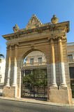 Malta - Streets of St Paul's Bay. Old limestone gate in the historic part of the popular town of Saint Paul's Bay (San Pawl il-Bahar) - Malta Stock Images